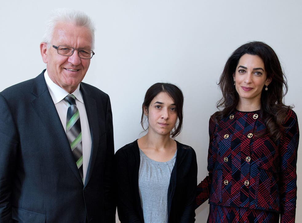 Premier of federal state Baden-Wuerttemberg Winfried Kretschmann (L) meets with Yezidi woman Nadia Murad (C) and British human rights attorney Amal Clooney (R) at the state ministry in Stuttgart, Germany, 12 September 2016. Amal Clooney is campaigning for international awareness of the Yezidi people's situation in the northern Iraq.