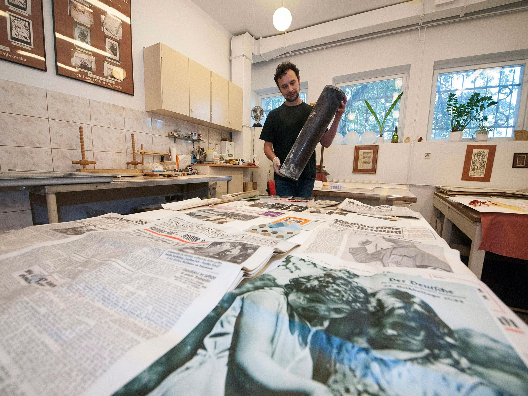 Nazi time capsule: Newspapers, photographs and copies of Mein Kampf found 'perfectly preserved' in Poland