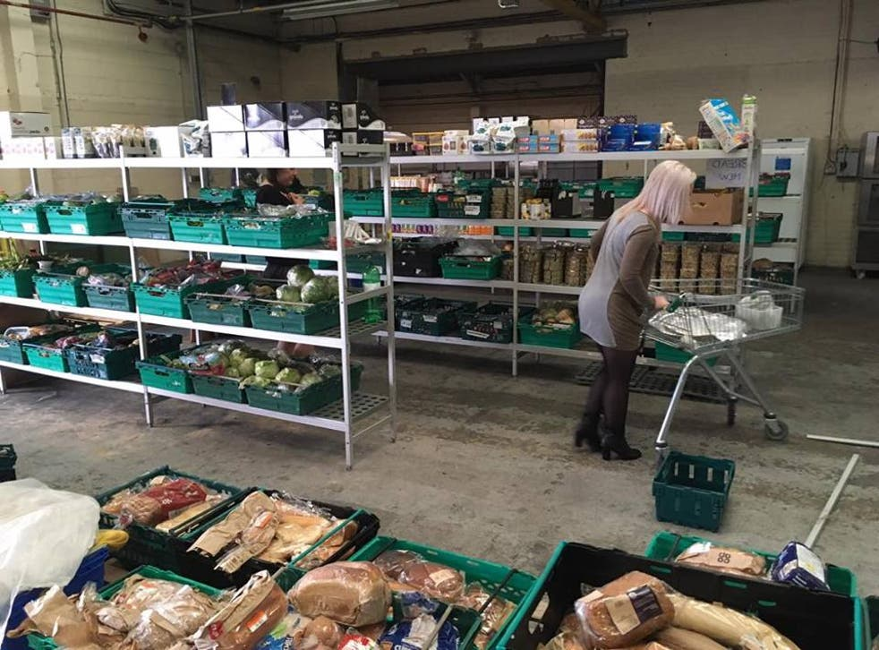 A shopper browses the shelves in the UK's first food waste supermarket