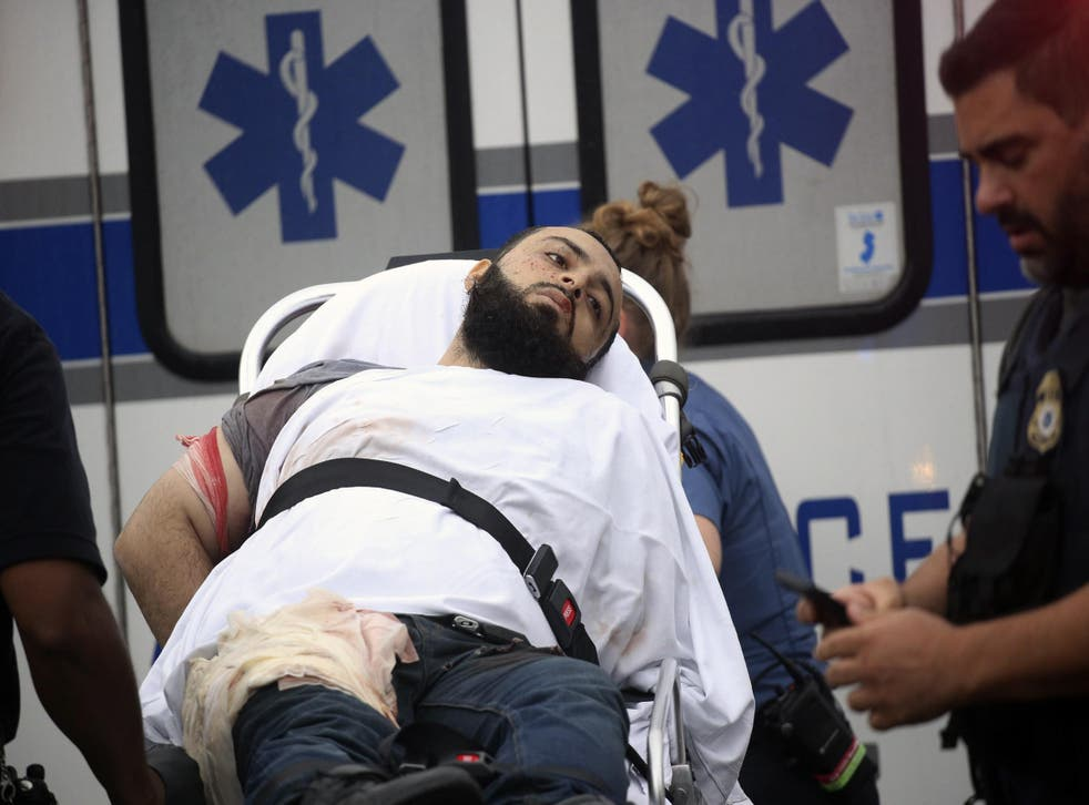 Ahmad Khan Rahami is taken into custody after a shootout with police on Monday