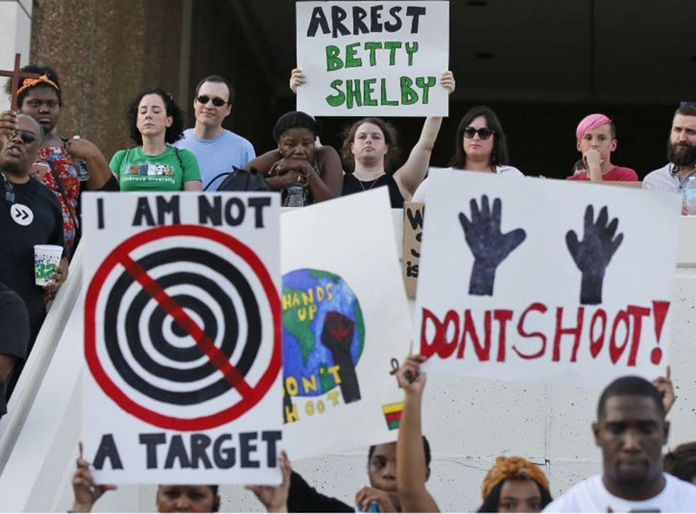 People hold signs at a 'protest for justice' over the shooting of Terence Crutcher, sponsored by We the People Oklahoma, in Tulsa, Oklahoma, 20 September, 2016