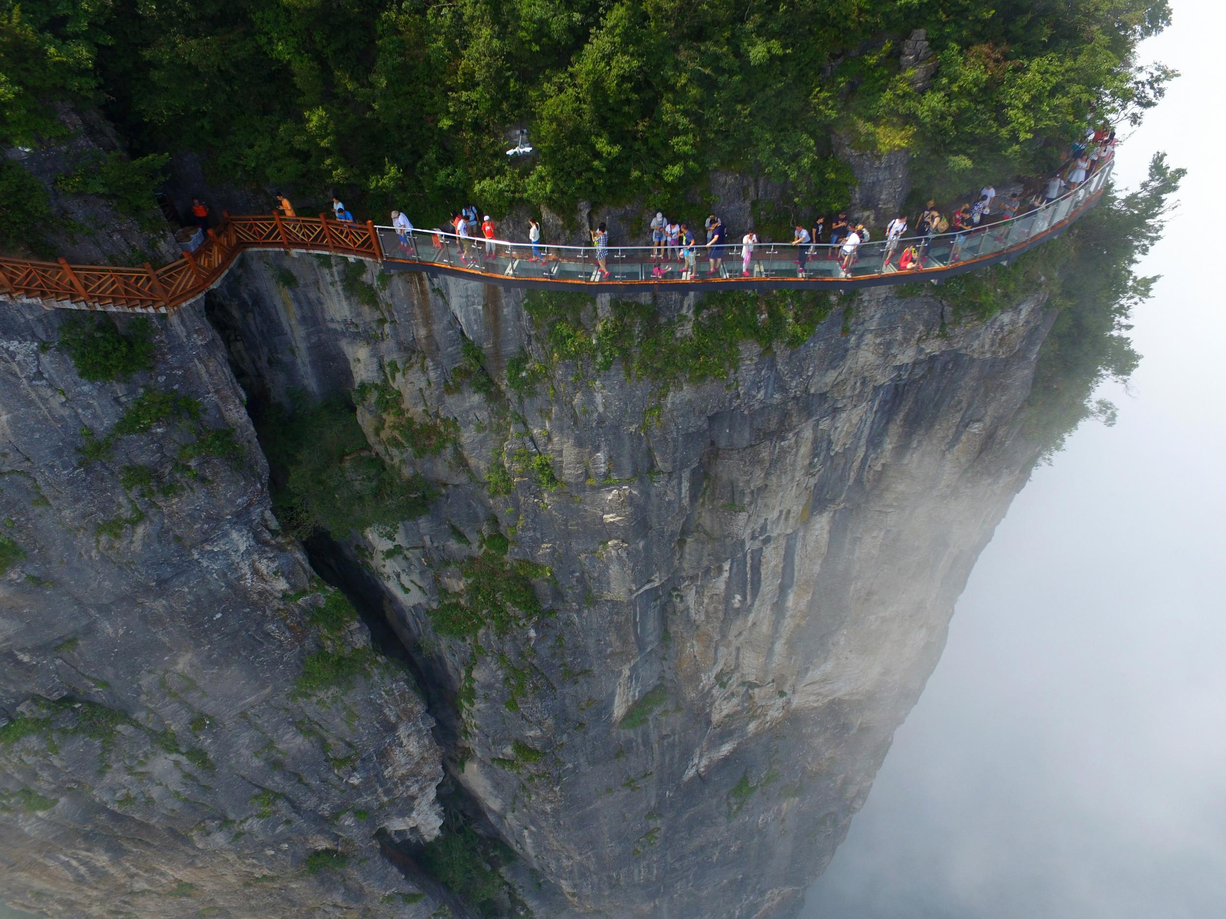 China's most terrifying tourist attractions, from the world's tallest glass bridge to a 1,000ft high cliff swing