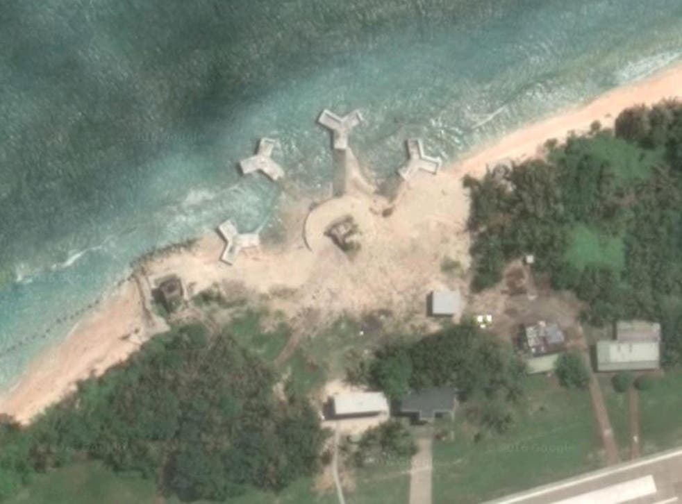Satellite images show buildings built on one of the disputed Spratly islands