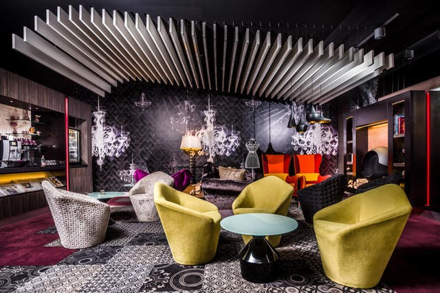 Rich colours and fabric are a feature of the Hotel Parlament bar