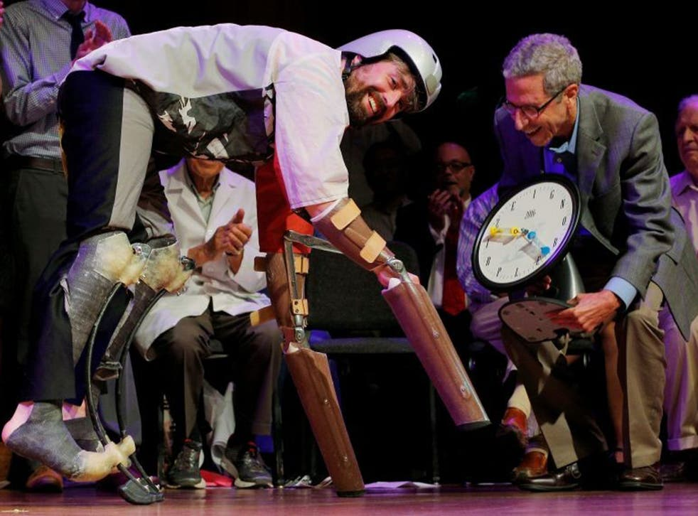 Nobel Laureate Eric Maskin presents the 2016 Ig Nobel Prize in Biology to Thomas Thwaites
