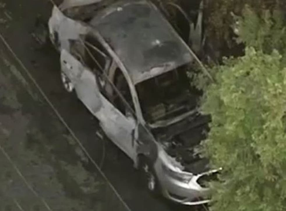 A man was injured after a firebomb was thrown into his car while he was inside