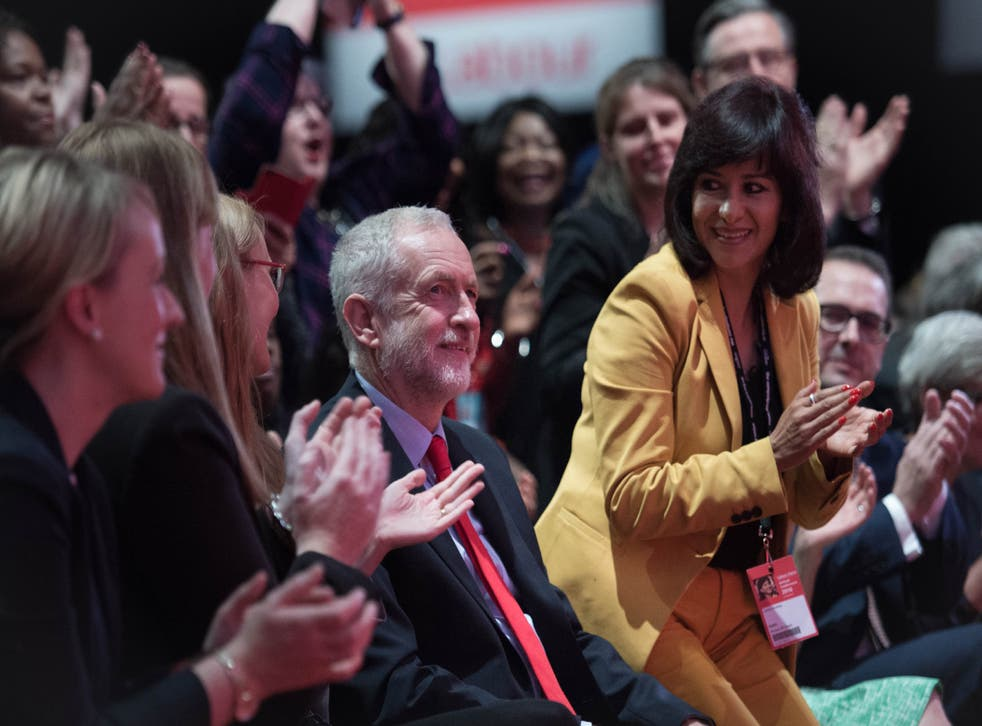 Jeremy Corbyn's allies applaud him as he is re-elected leader but divisions remain