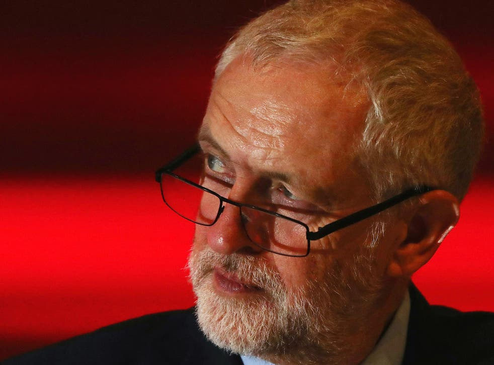 Jeremy Corbyn listens to a speaker on the third day of the Labour Party conference