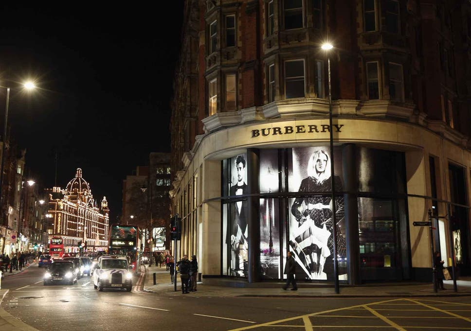 48d9b7ce718b Burberry reports jump in profit and announces shift away from non-luxury  market
