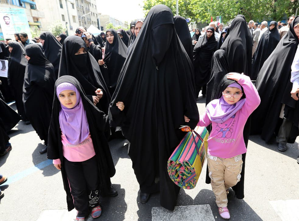 Iranian hardliners calling for the government to enforce rules governing women's dress in Tehran in 2014