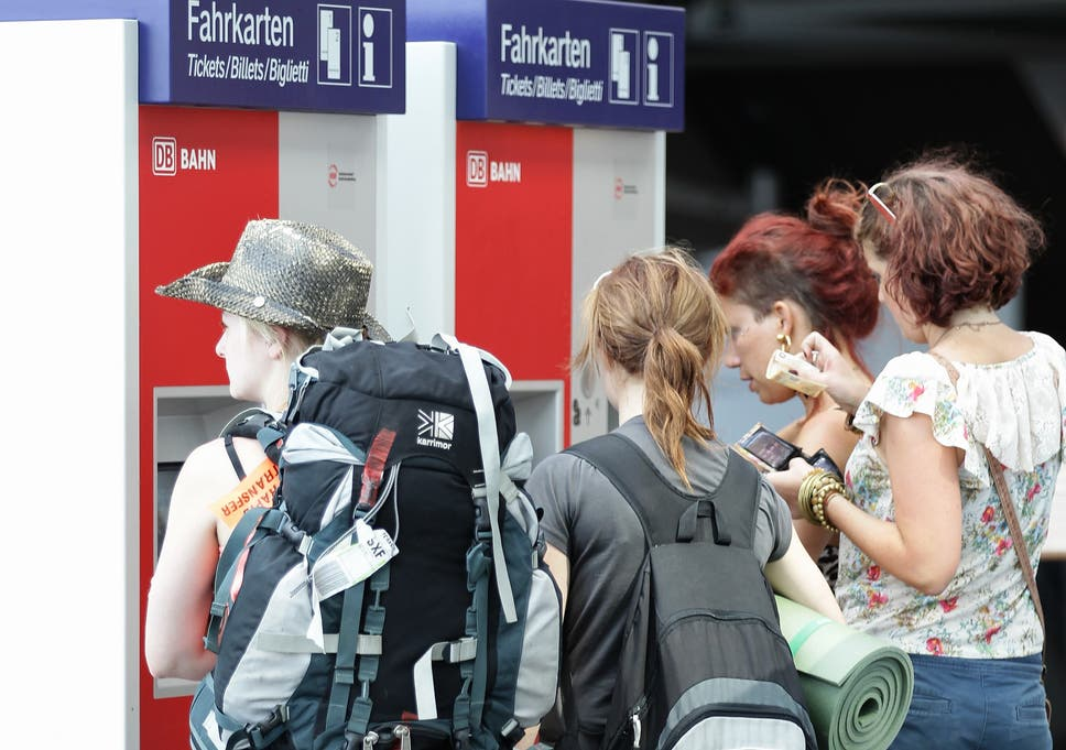 Eu plans to give free interrail pass to every 18 year old in europe backpackers queue up at a ticket machine at hauptbahnhof train station in berlin germany fandeluxe Images