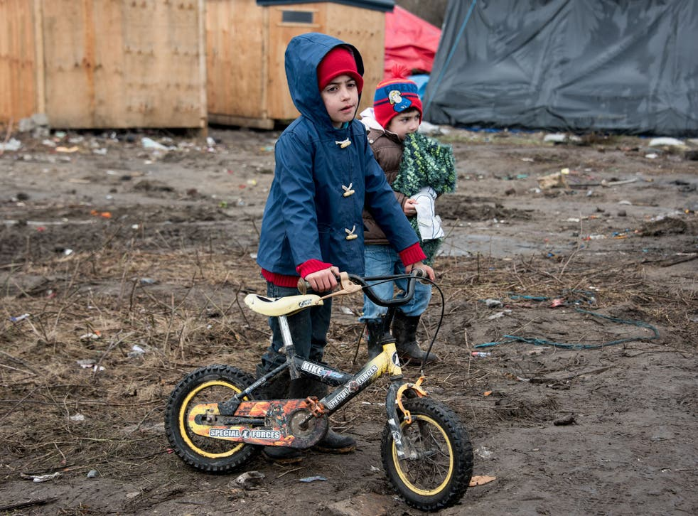 Refugee children playing in the Calais camp which Francois Hollande has vowed to close by the end of the year