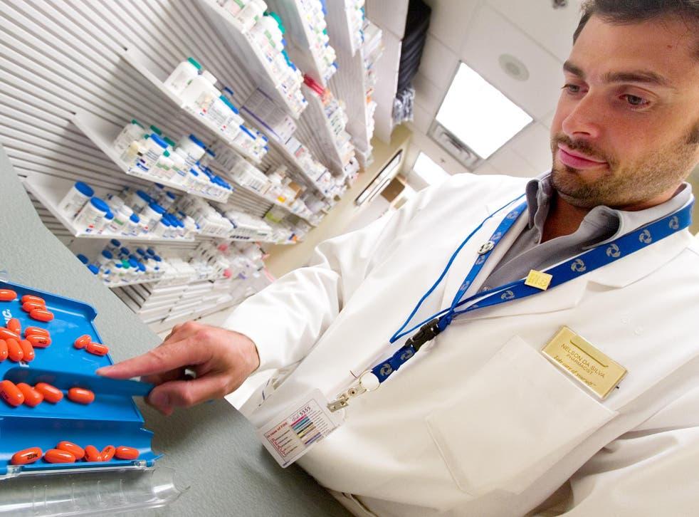 A pharmacist dispenses HIV drugs
