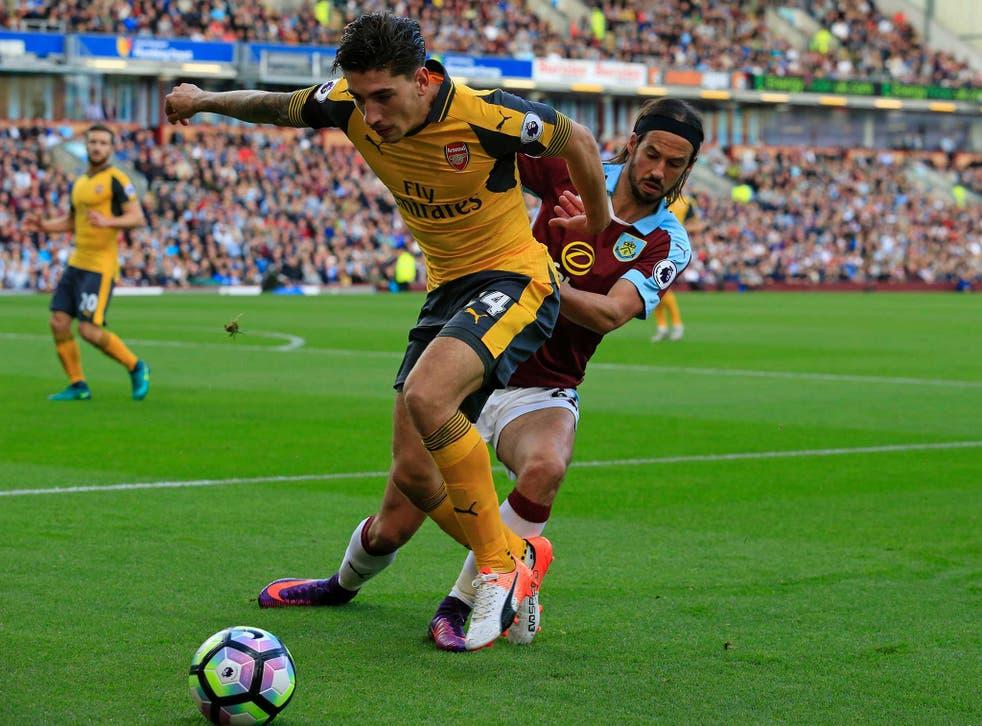 Hector Bellerin jostles for possession against Burnley