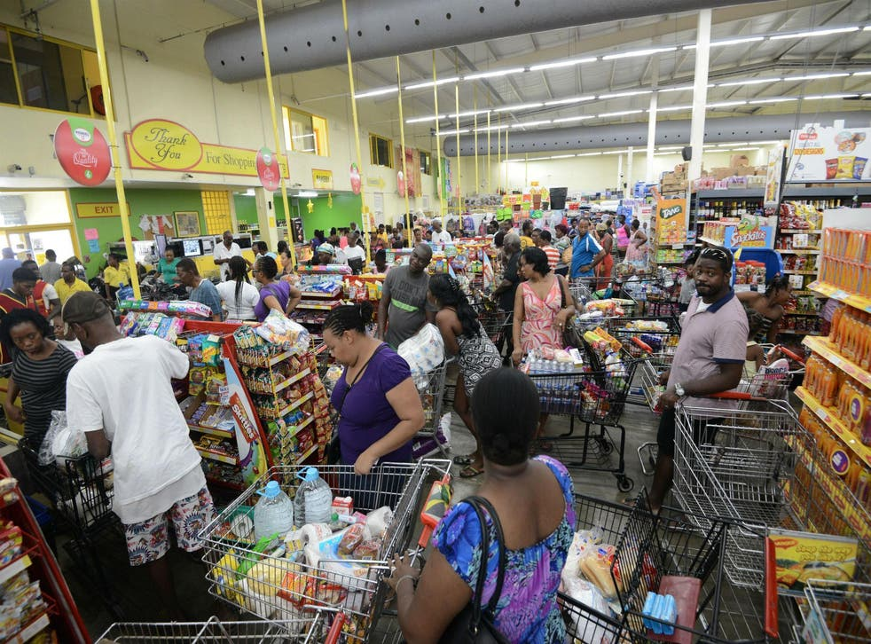 Shoppers in Jamaica stock up on emergency supplies ahead of Hurricane Matthew's arrival