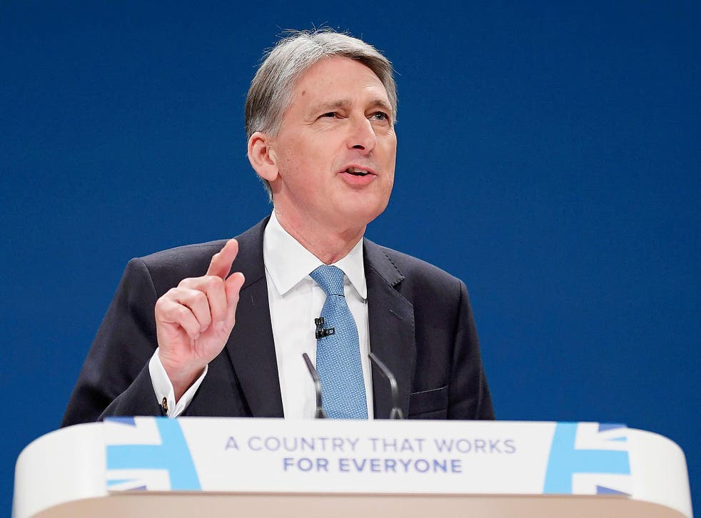 Britain's Chancellor of the Exchequer Philip Hammond speaks at the Conservative Party conference in Birmingham, England.