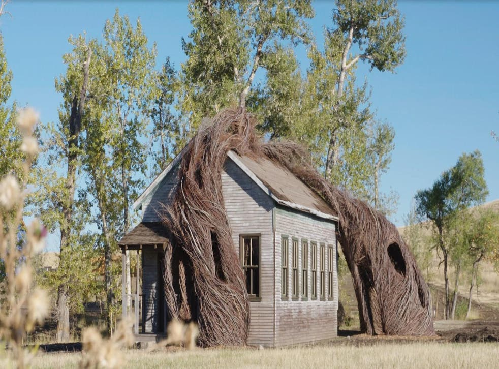 Daydreams, by Patrick Dougherty, sees a fake 19th-century schoolhouse overtaken by willow trees