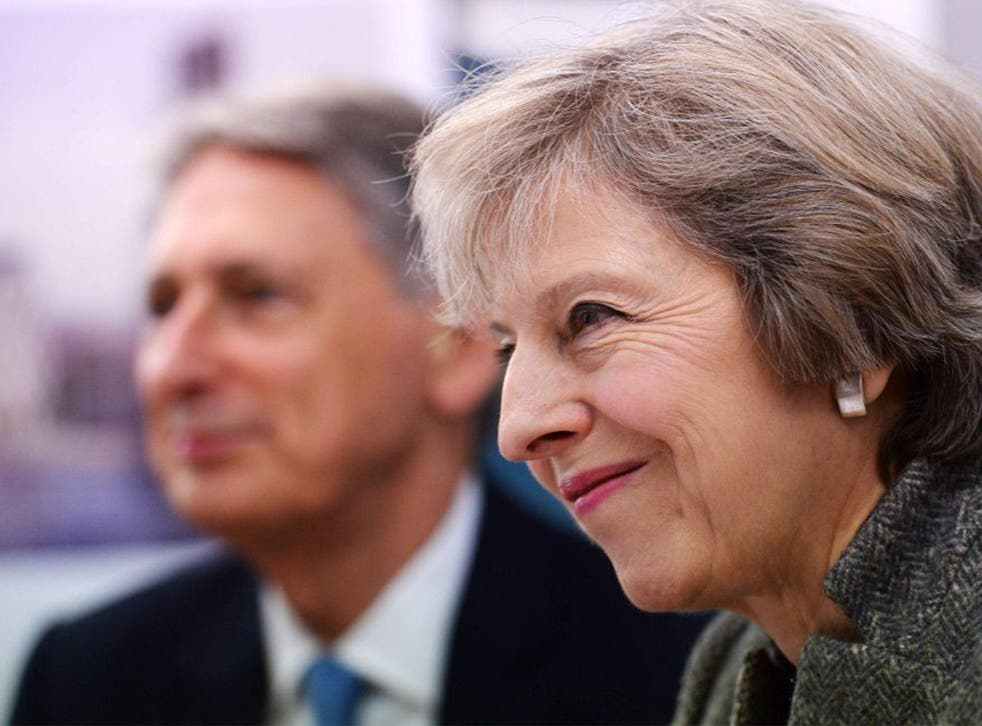 Hammond with Theresa May in Birmingham