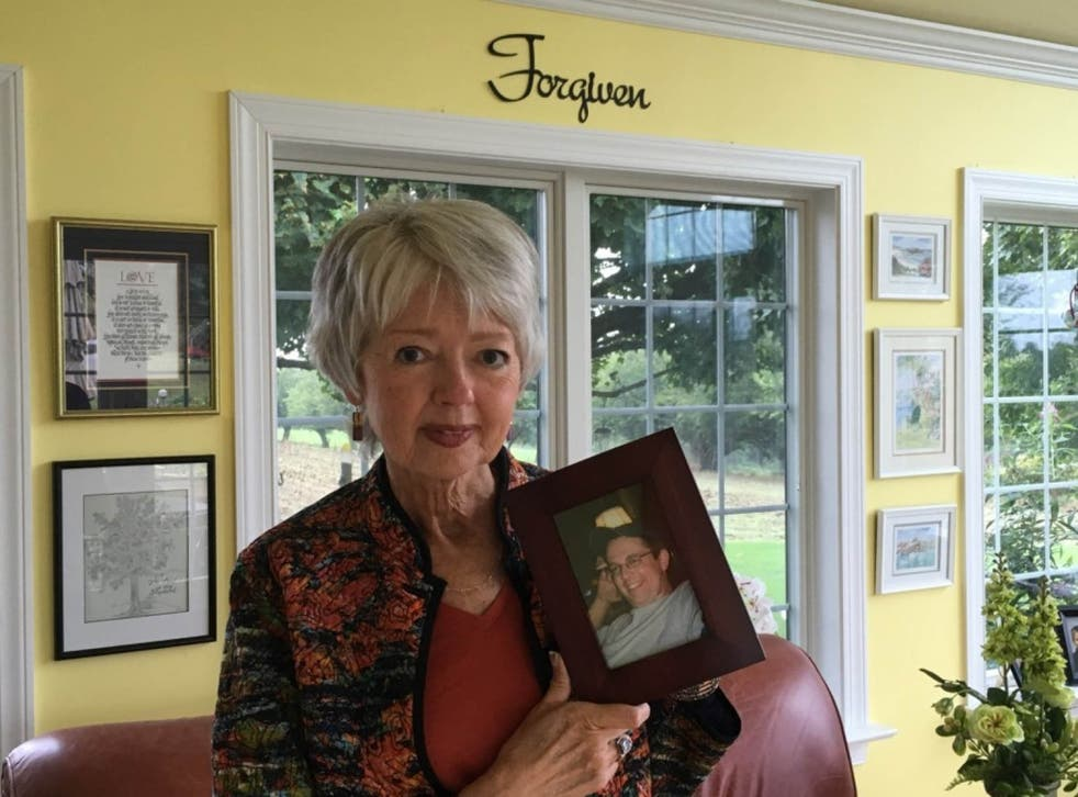 Terri Roberts holds a photo of her son, Charles Carl Roberts, who shot and killed Amish girls in their schoolhouse 10 years ago (Colby Itkowitz/The Washington Post)