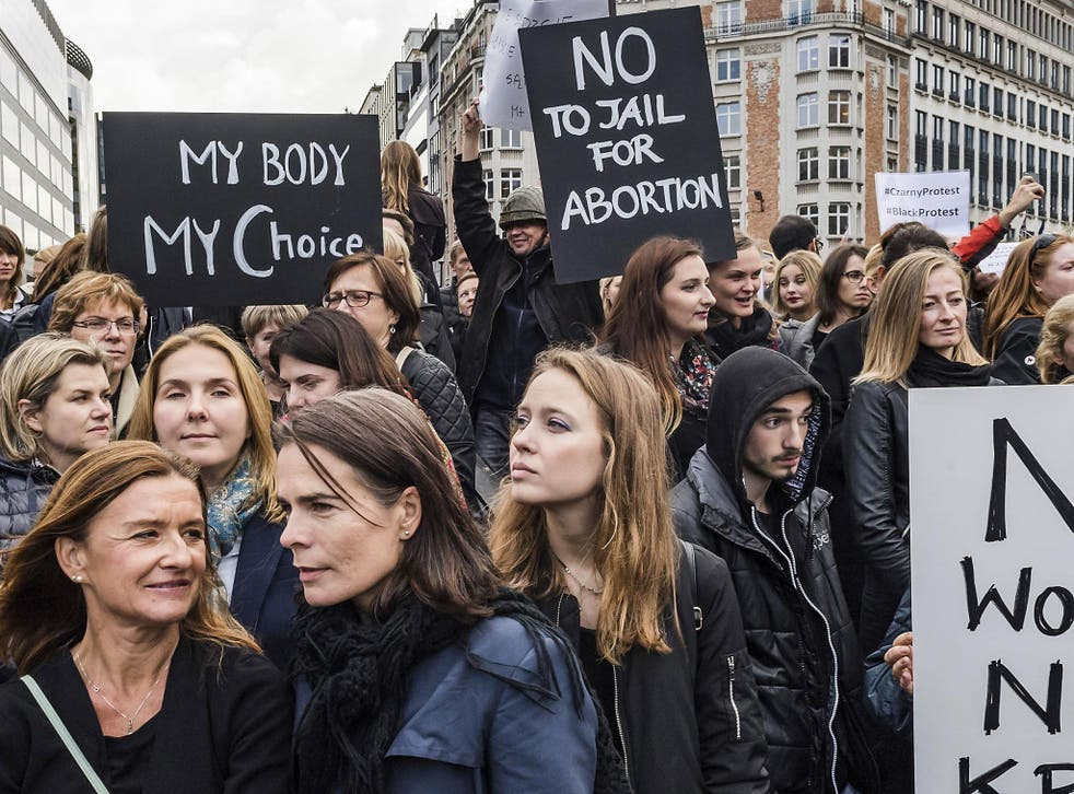 Polish women protest against a legislative proposal for a total ban on abortion in Poland, during a demonstration near EU headquarters in Brussels