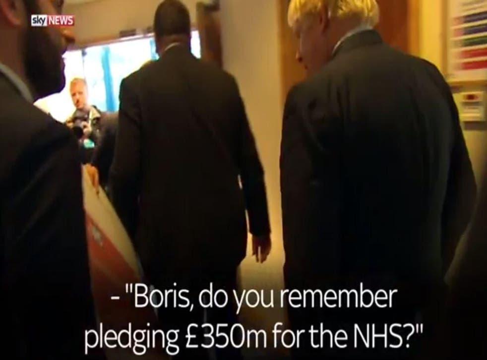 Boris Johnson is confronted by Sky News' Darren McCaffrey