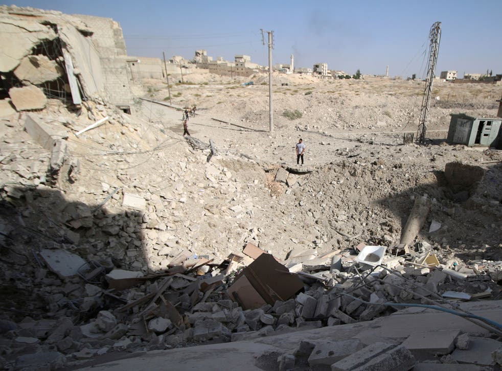 The crater left after an air strike in the rebel held Karam Houmid neighbourhood in Aleppo