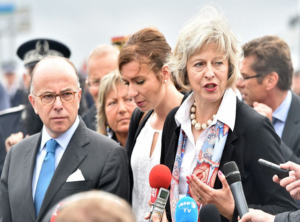 French Interior Minister Bernard Cazeneuve (left) and Theresa May pictured last year at a photocall about joint policing
