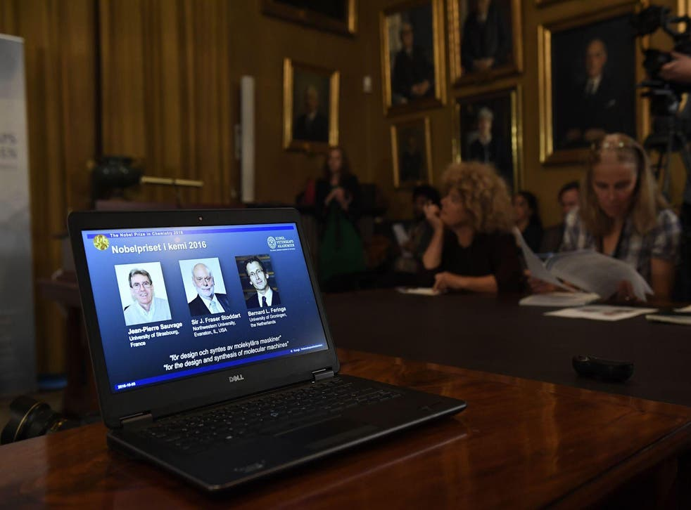 Sir J Fraser Stoddart (centre) appears on a laptop screen as he, Jean-Pierre Sauvage and Bernard L Feringa are proclaimed the winners of the Nobel Prize for Chemistry