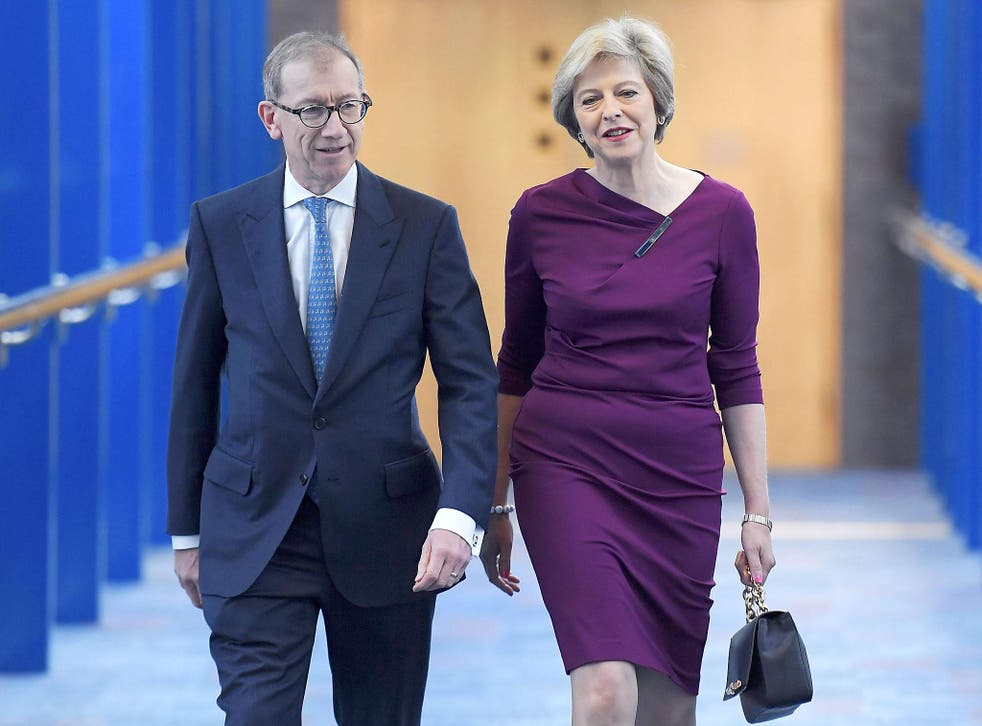 Britain's Prime Minister Theresa May and her husband Philip arrive on the final day of the annual Conservative Party Conference in Birmingham