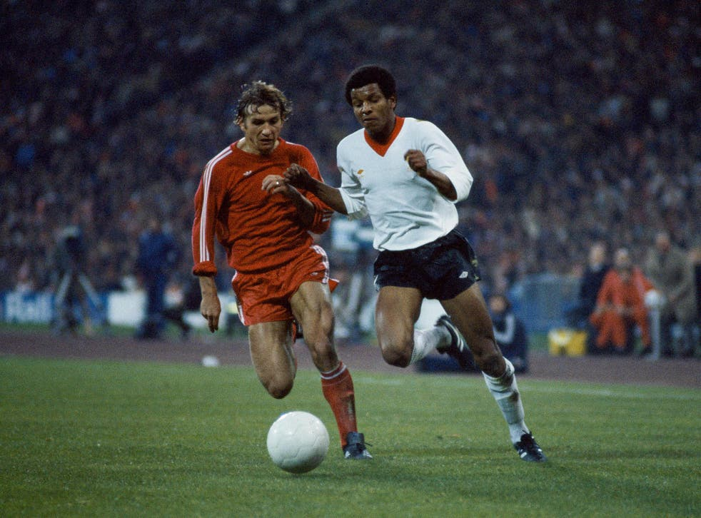 Howard Gayle storms past Wolfgang Dremmler in the second-leg of Liverpool's semi-final clash against Bayern Munich in the European Cup, April 1981 (Getty)