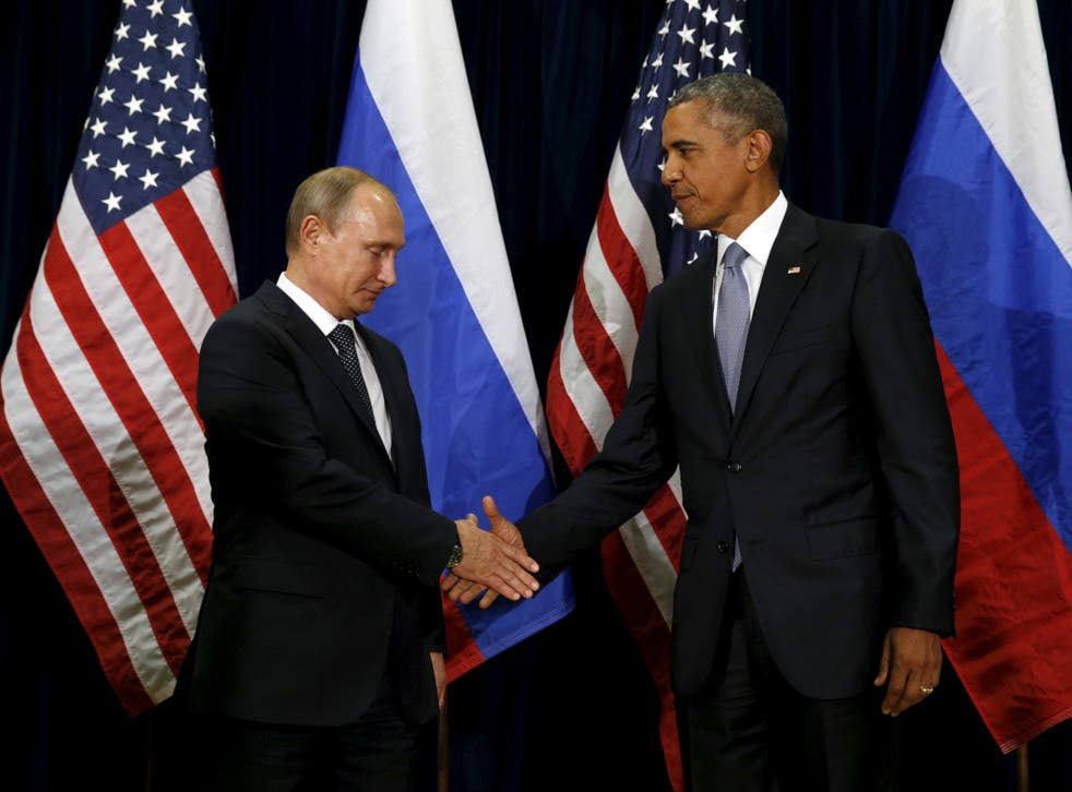 US President Barack Obama shakes hands with Russian President Vladimir Putin in happier times
