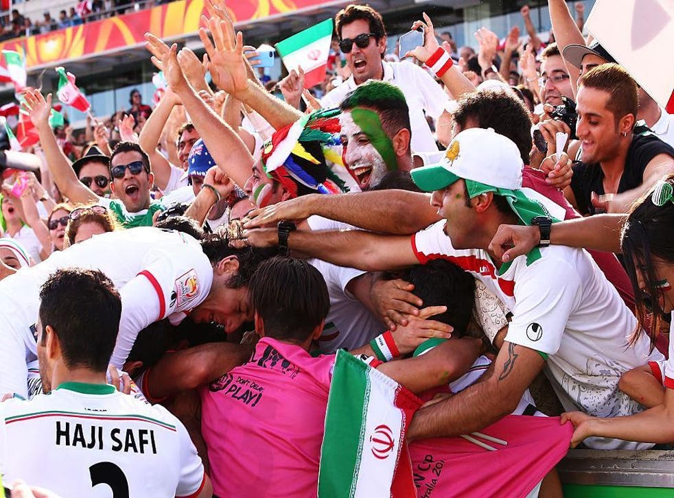 Sardar Azmoun of Iran celebrates with team mates and fans after scoring a goal during the 2015 Asian Cup match between Iran and Iraq at Canberra Stadium on January 23, 2015 in Canberra, Australia
