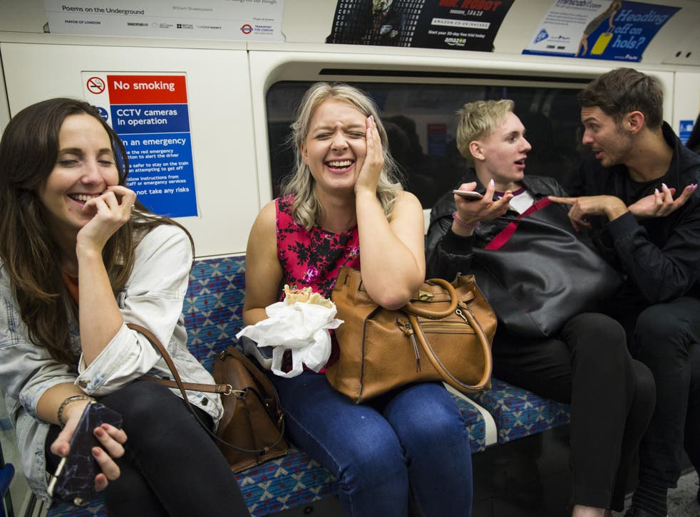 Passengers sit on board the Night Tube along the Victoria line on August 20, 2016 in London, England.
