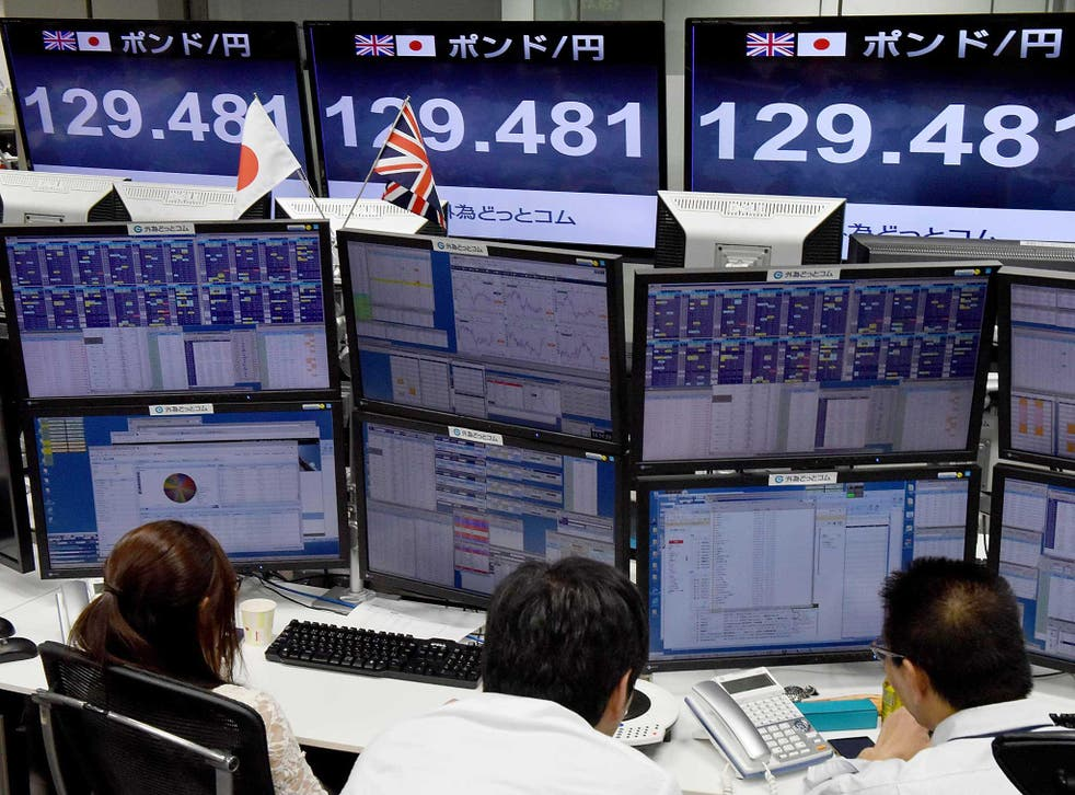 "Traders check computer screens showing the Japanese yen rate against the British pound at a brokerage in Tokyo.The pound suffered a ""flash crash"" in Asia on a computer-generated sell-off in the beleaguered currency."