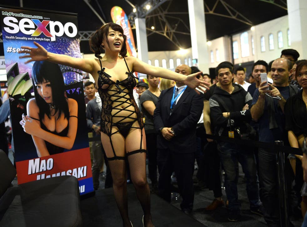 Japanese adult film star Mao Hamasaki — who was not forced into her career — greets fans