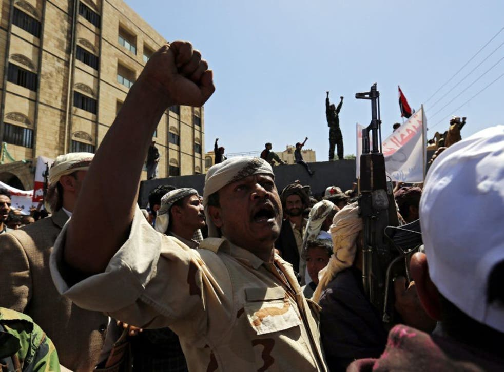 Yemenis shout anti-Saudi slogans outside the UN offices in Sana'a