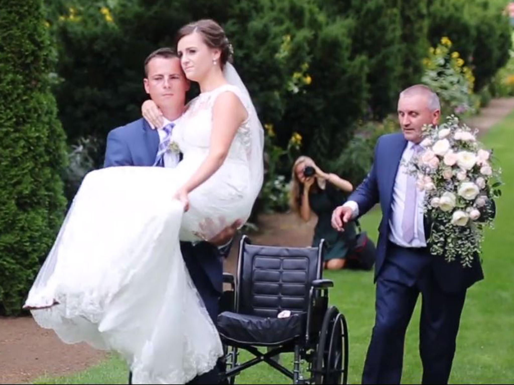Woman seriously injured in car crash gets carried down the aisle by groom weeks later