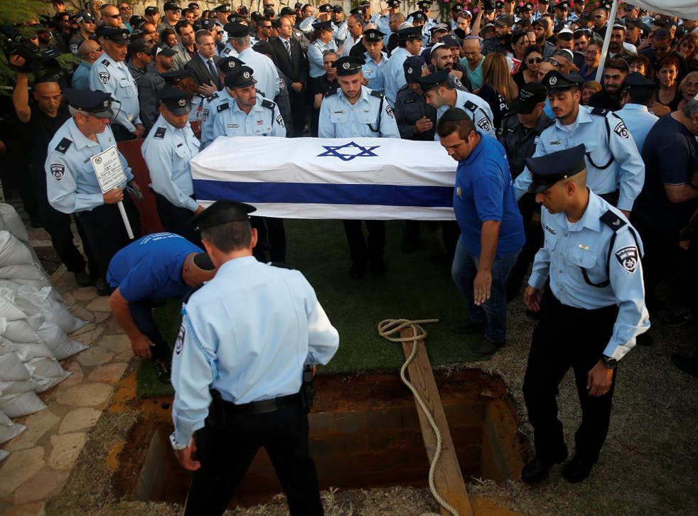 Israeli policeman Yosef Kirma was given a public funeral after being killed by a Palestinian assailant who fired from a car in East Jerusalem, leaving two dead and five injured