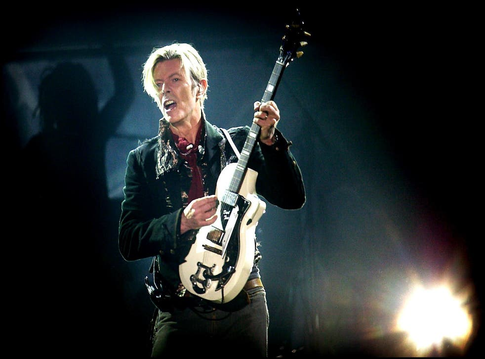 David Bowie performs on stage at the Forum in Copenhagen October 7. 2003.