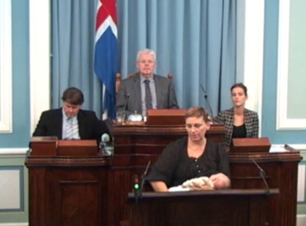 Independence Party MP Unnur Brá Konráðsdóttir breastfeeds her baby at the podium