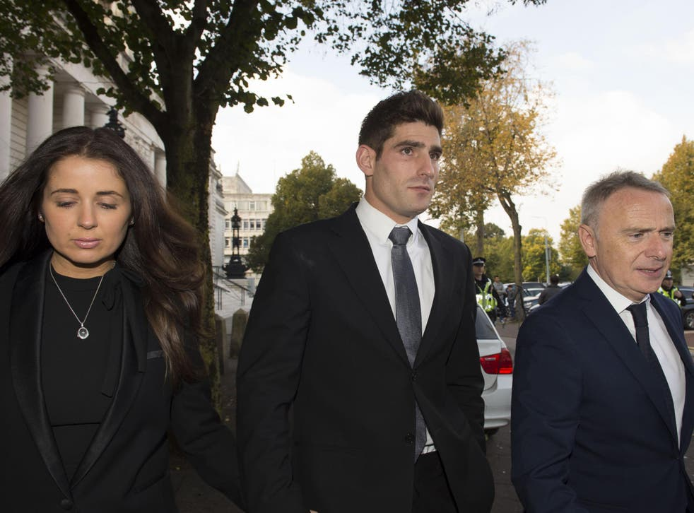 Chesterfield FC football player Ched Evans leaves Cardiff Crown Court with partner Natasha Massey after being found not guilty of rape