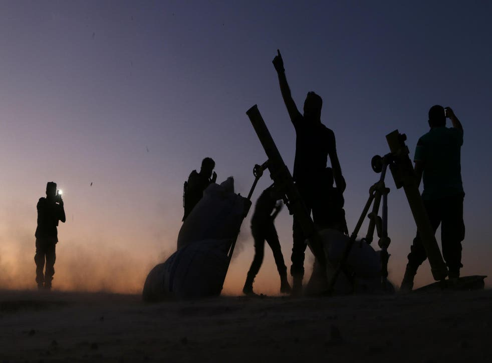 Fighters from the Free Syrian Army cheer and react as they defeat Isis in Dabiq