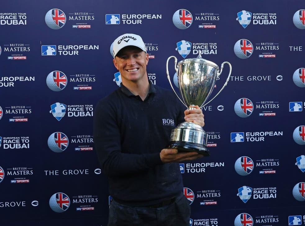 Alex Noren celebrates winning the British Masters