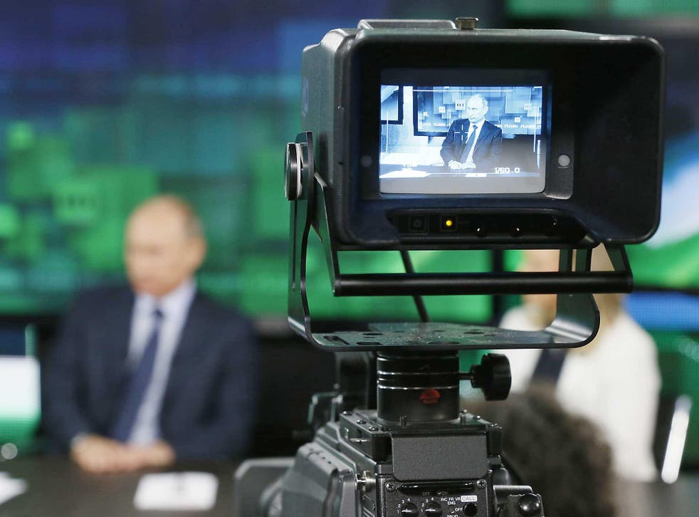 Russian President Vladimir Putin is seen on the screen of a television camera during his visit to the new studio complex of television channel 'Russia Today' in Moscow