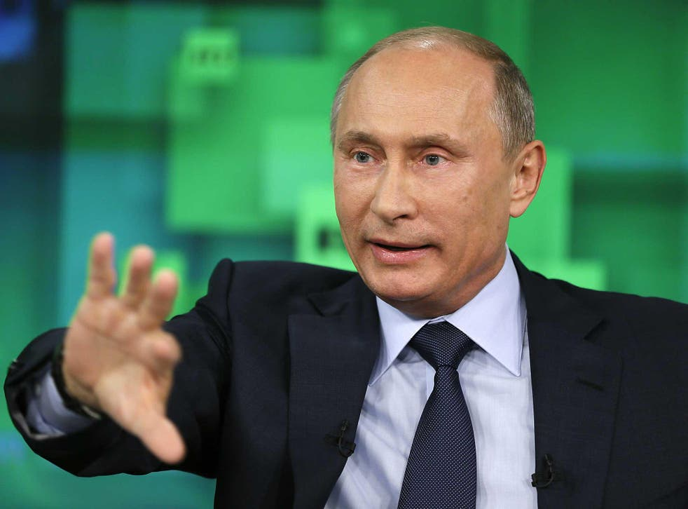 President Vladimir Putin speaks during his visit to the new studio complex of television channel 'Russia Today' in Moscow