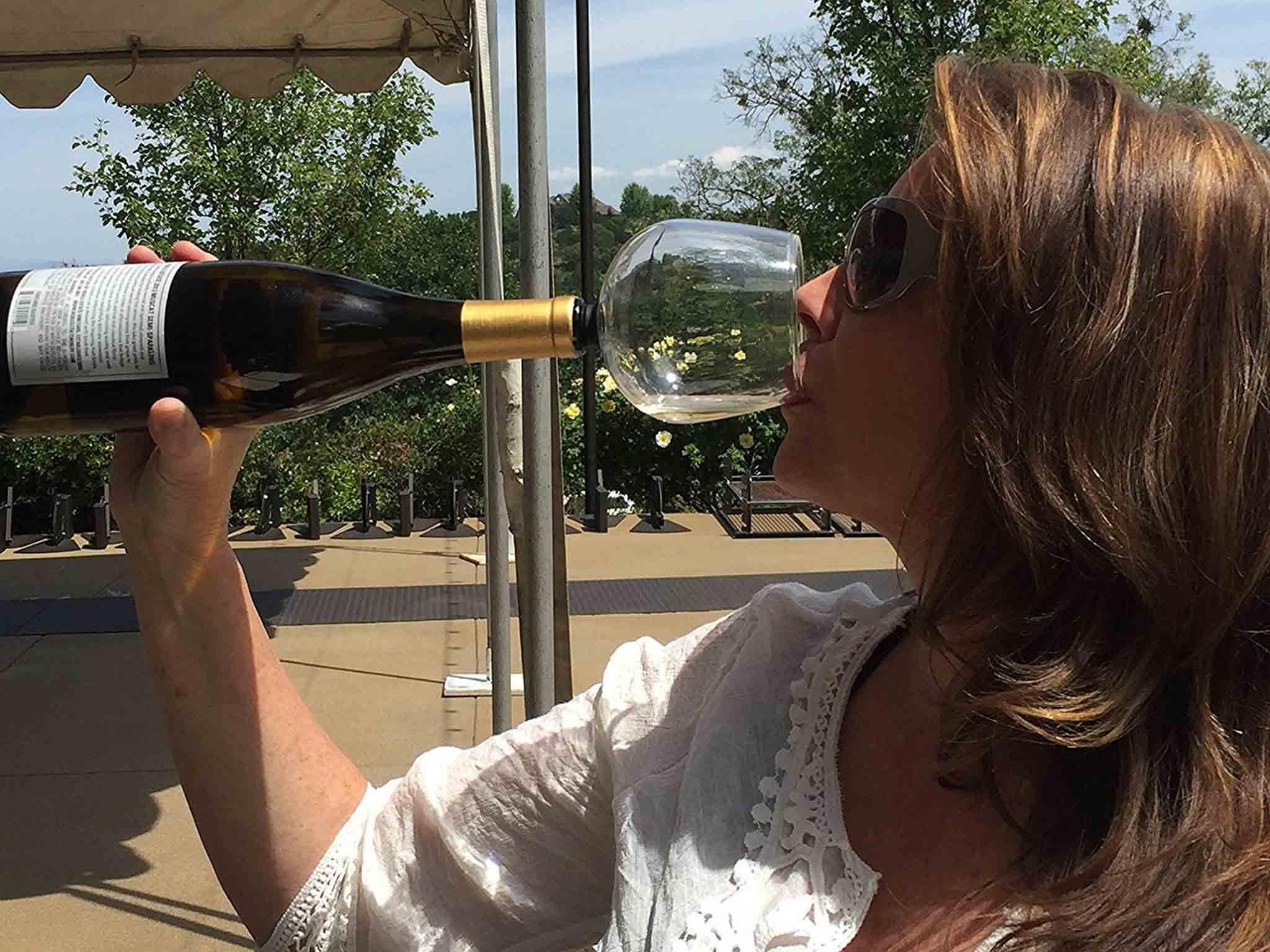 New wine glass attaches to bottle to let you fill your glass even faster