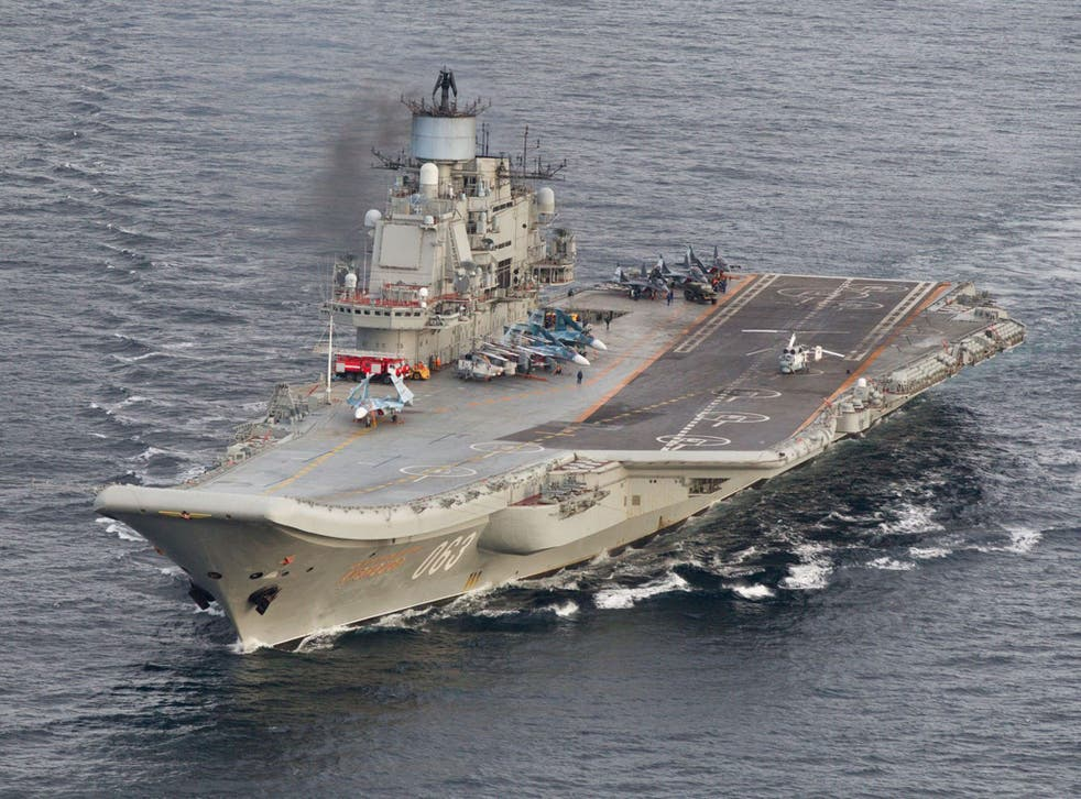 A photo taken from a Norwegian surveillance aircraft shows Russian aircraft carrier Admiral Kuznetsov in international waters off the coast of Northern Norway on October 17, 2016.