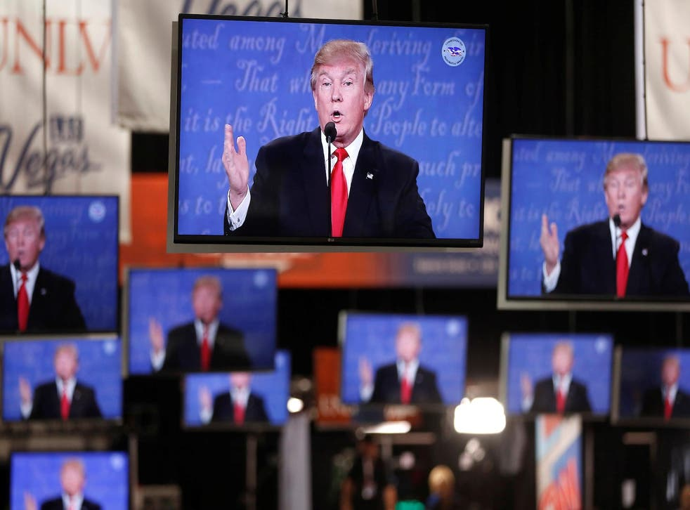 Republican U.S presidential nominee Donald Trump is shown on TV monitors in the media filing room on the campus of University of Nevada