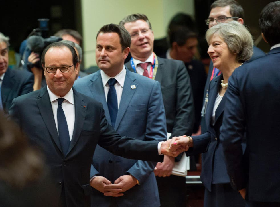 Theresa May mingles with other EU leaders at the summit in Brussels