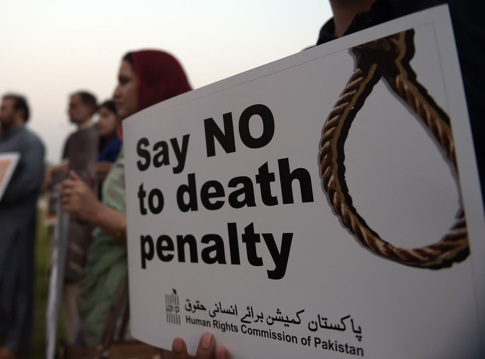 Activists from the Human Rights Commission of Pakistan (HRCP) carry placards during a demonstration to mark International Day Against the Death Penalty in Islamabad on October 10, 2015